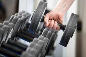 hand holding dumbell in gym