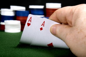 pair of aces in poker with poker chips