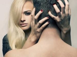 woman hugging man on neck