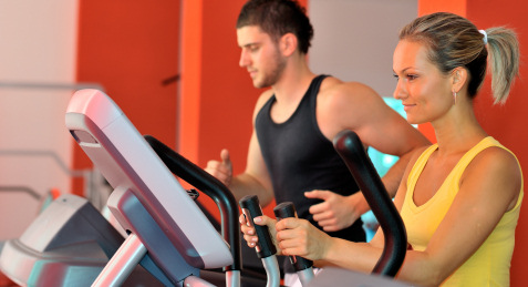 two people working out in the gym