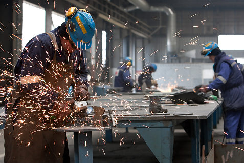 factory worker sparks flying