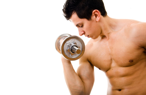 shirtless man working out with dumbell