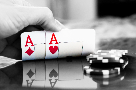 pair of aces in poker black and white
